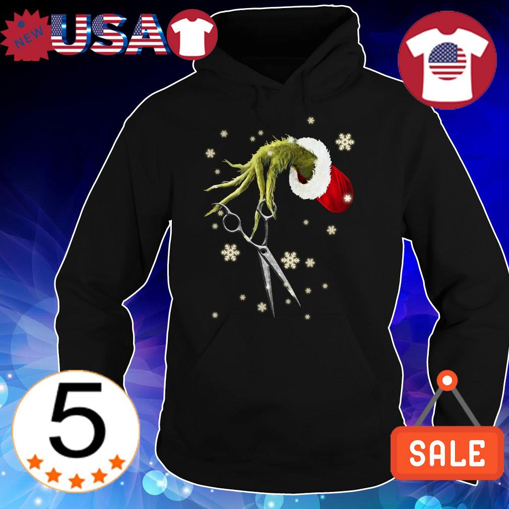The Grinch holding a scissors Christmas sweater