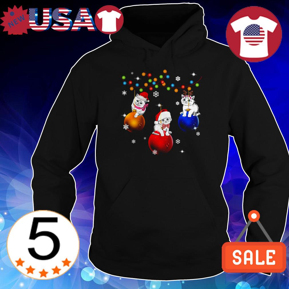 Cat sitting on jingle bells Christmas sweater