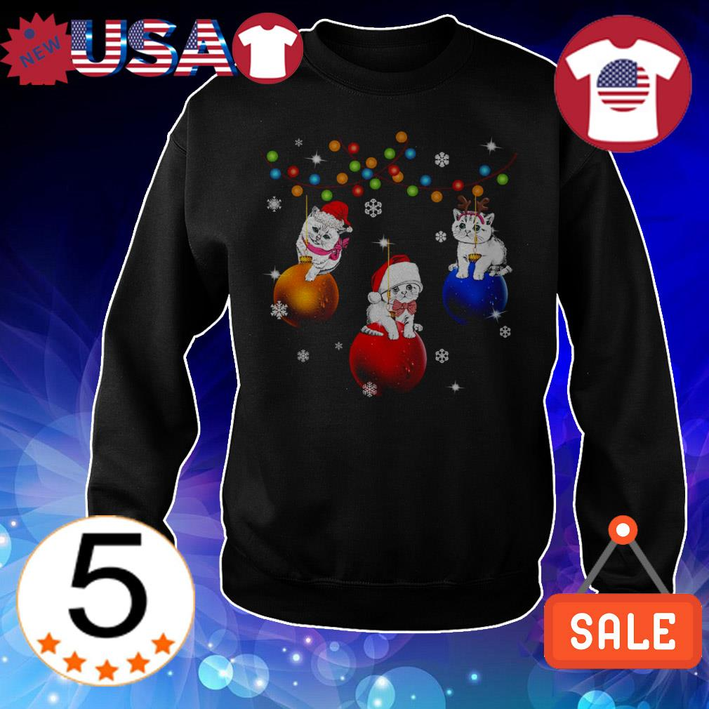 Cat sitting on jingle bells Christmas sweater