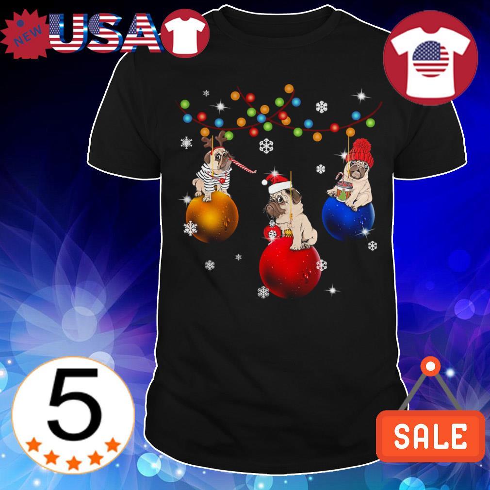 French Bulldog sitting on jingle bells Christmas sweater