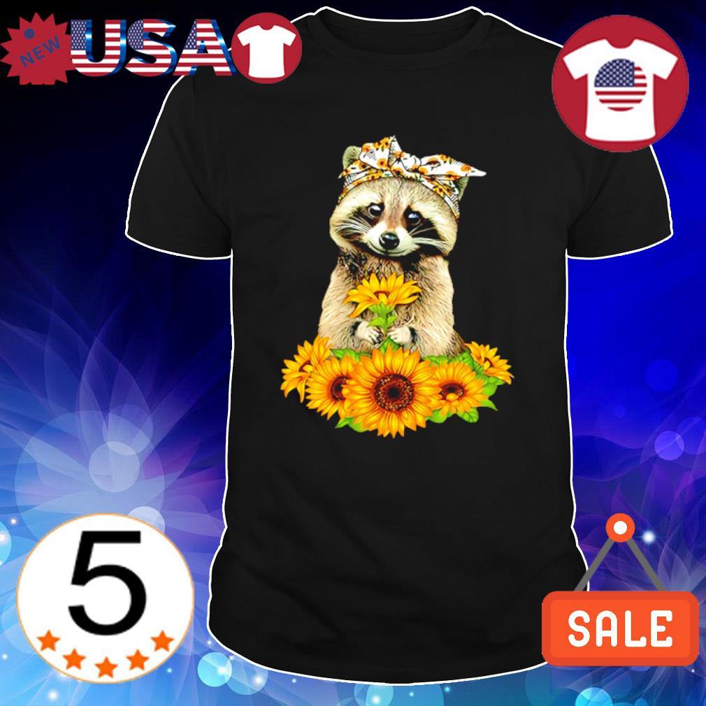 Raccoon holding sunflower shirt